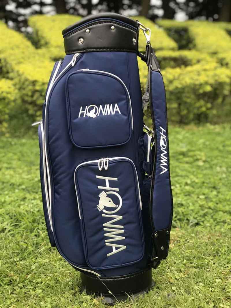 Túi gậy golf vải dù Honma có thiết kế nhiều ngăn giúp bạn đựng được nhiều đồ